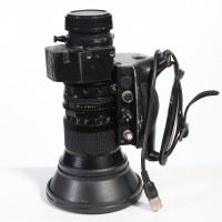 Includes Lens Hood, back cap. All functions seem in working order and all elements clear